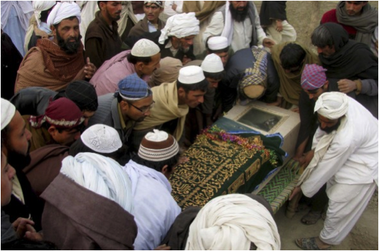 On December 28th 2010 a drone strike killed 2 to 4 civilians in Ghulam Khan, North Waziristan.. 2 were identified as  Jamil and Mustafaa. Above Pakistani villagers look upon the casket of a victim.