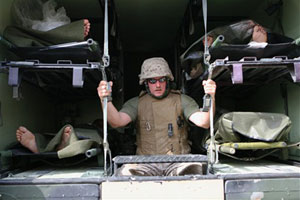 Soldier with wounded troops